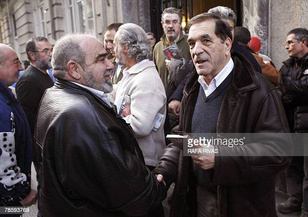 Former member of proindependence banned Basque party Batasuna National Board Jose Luis Elkoro shakes hands with Basque Nationalist Action political...