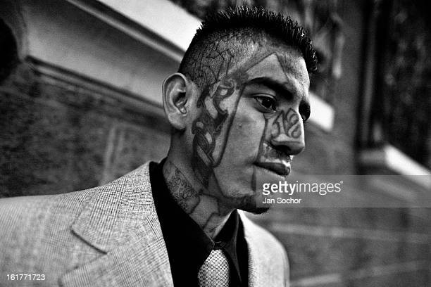 Former member of the 18th Street Gang seen on his way to the church in San Salvador, El Salvador, 12 May 2011. During the last two decades, Central...