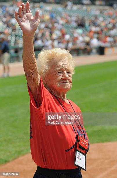 Former member of the AllAmerican Girls Professional Baseball League Helen 'Fil' Filarski waves to the crowd during a ceremony before the game between...