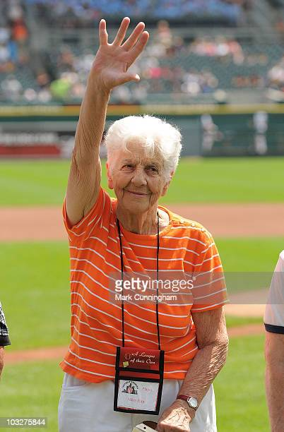 Former member of the AllAmerican Girls Professional Baseball League Mary Rini waves to the crowd during a reunion ceremony before the game between...