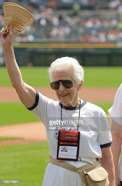 Former member of the AllAmerican Girls Professional Baseball League Lucella Ross waves to the crowd during a reunion ceremony before the game between...