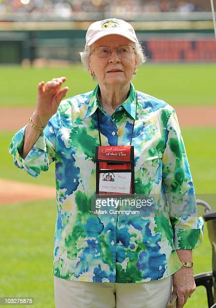 Former member of the AllAmerican Girls Professional Baseball League Helen 'Gig' Smith waves to the crowd during a reunion ceremony before the game...