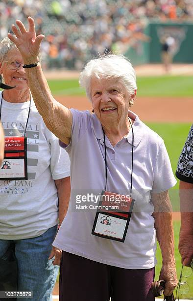 Former member of the AllAmerican Girls Professional Baseball League Mary Pratt waves to the crowd during a reunion ceremony before the game between...