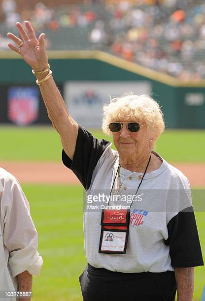 Former member of the AllAmerican Girls Professional Baseball League Marilyn 'Jonesy' Doxey waves to the crowd during a reunion ceremony before the...