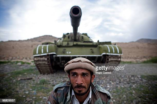 A former member of the Mujahideen jumpsover Sovietera tanks currently held in a junk scrapyard on May 2 south of Kabul These tanks have changed hands...