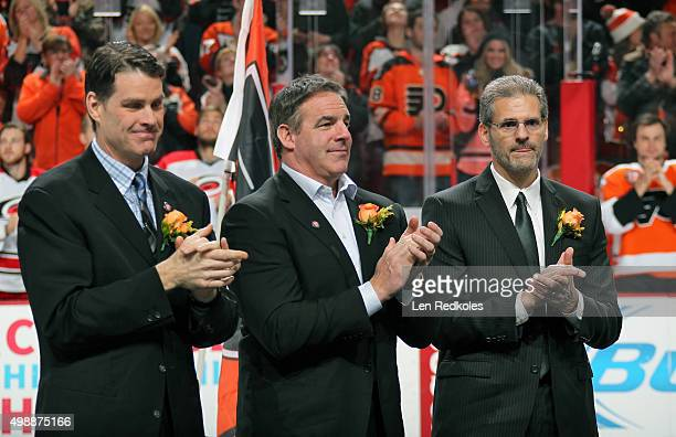 Former member of the Philadelphia Flyers Chris Therien John LeClair and Ron Hextall applaud during Rod Brind'Amour's Flyers Hall of Fame Induction...