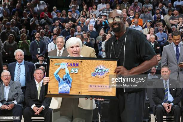 Former member of the Utah Jazz Antoine Carr is honored during halftime of the New York Knicks game against the Utah Jazz at vivintSmartHome Arena on...