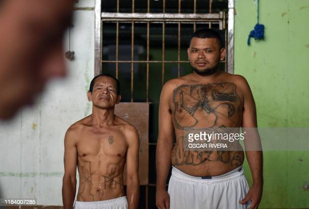 Former members of Barrio 18 and MS-13 gang are pictured at Santa Ana prison, 60 km northwest of San Salvador, on May 21, 2019. - Former members of...