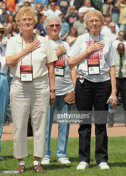 Former members of the AllAmerican Girls Professional Baseball League Marilyn Jenkins Mary 'Sis' Moore and Gloria 'Cordes' Elliott stand on the field...