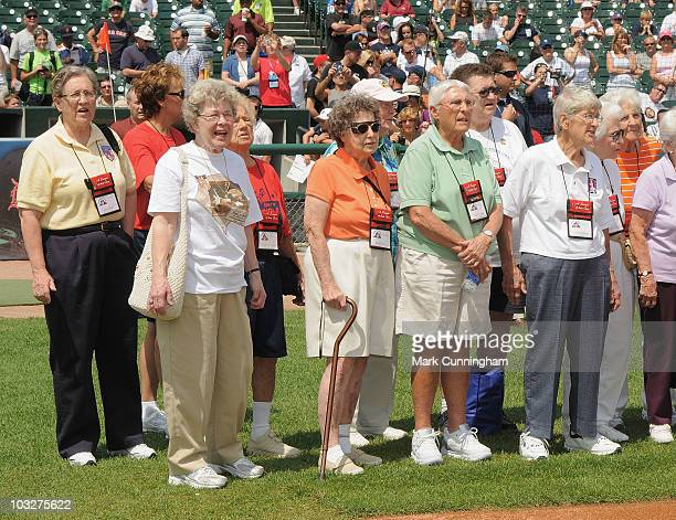 Former members of the AllAmerican Girls Professional Baseball League stand on the field during a reunion ceremony before the game between the Detroit...