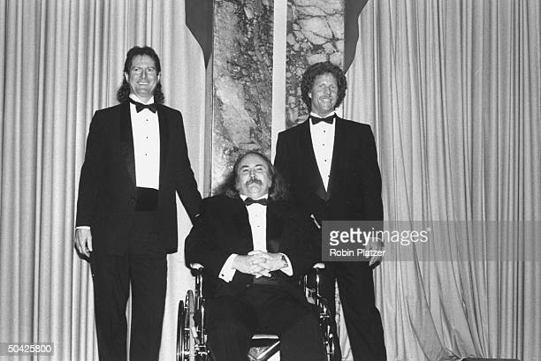 Former members of the Byrds Roger McGuinn David Crosby in wheelchair Chris Hillman at Rock Roll Hall of Fame dinner WaldorfAstoria