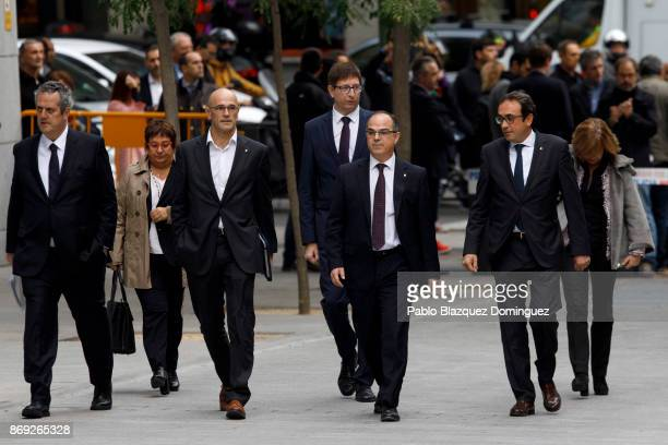 Former members of the Catalan government Joaquin Forn Dolors Bassa Raul Romeva Carles Mundo Jordi Turull Josep Rull and Meritxel Borras arrive at...