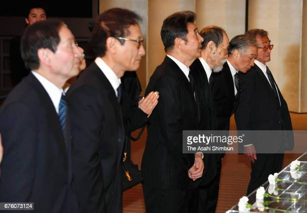 Former members of the Spiders offer flowers at an altar at the farewell meeting for late musician Hiroshi Kamayatsu on May 2, 2017 in Tokyo, Japan.