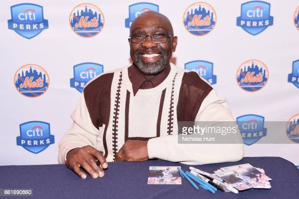 Former Met MLB player Mookie Wilson signs autographs during the Citi celebration of the start of the New York Mets season with the Let's Go Mets Fan...