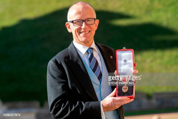 Former Metropolitan Police Assistant Commissioner for Specialist Operations and national lead for counterterrorism Mark Rowley poses with his medal...