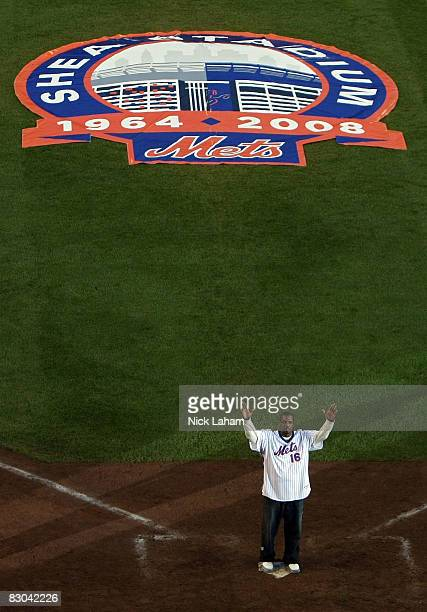 Former Mets pitcher Dwight Gooden greets fans from the field in a post game ceremony after the last regular season baseball game ever played in Shea...
