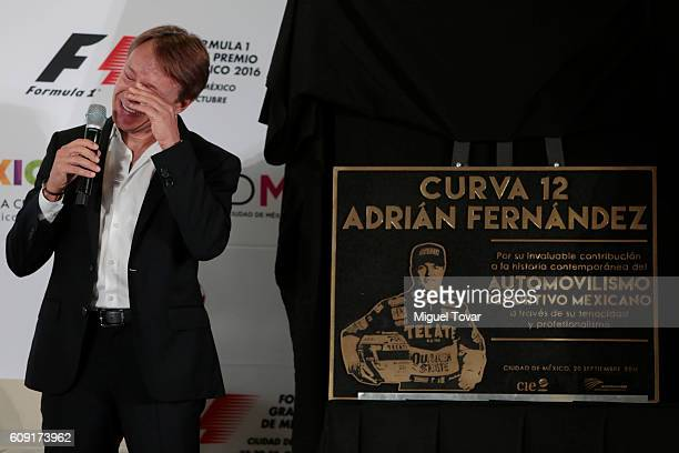 Former Mexican driver Adrian Fernandez gets emotional as he unveils a placard during a ceremony in his honour at Autodromo Hermanos Rodriguez on...