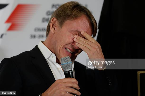 Former Mexican driver Adrian Fernandez gets emotional during a ceremony in his honour at Autodromo Hermanos Rodriguez on September 20, 2016 in Mexico...
