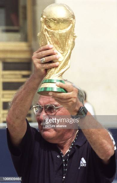Former Mexican goalkeeper Antonio Carbajal presents an imitation of the World Cup trophy withwhich he was awarded ahead of the 1998 World...