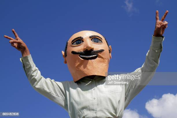A former Mexican president papermache mask parading at Arts in the Street Independence of Central America Mexico Cultural Integration Day