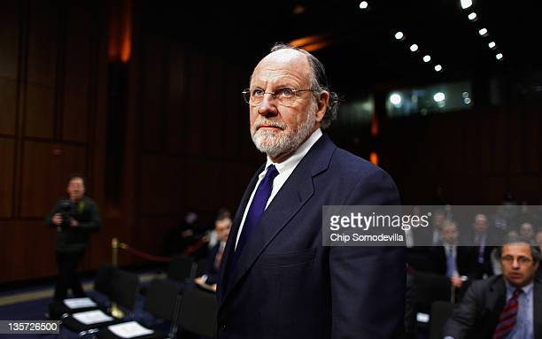 Former MF Global Chairman and CEO Jon Corzine prepares to testify before the Senate Agriculture Nutrition and Forestry Committee about the demise and...