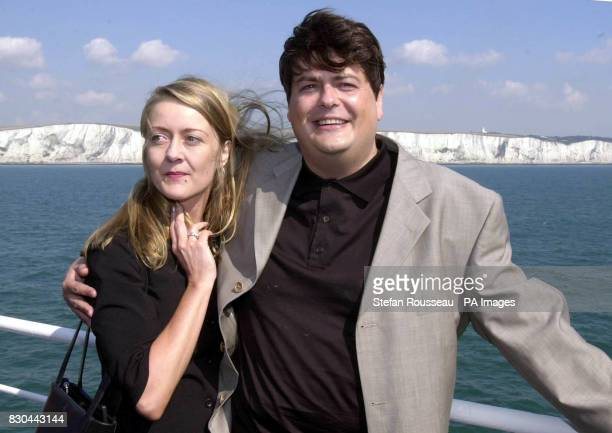 Former MI5 employee David Shayler and his girlfriend Annie Machon with the White Cliffs of Dover in the background arrive at the Kent port where he...