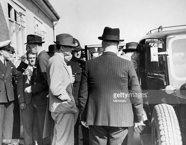 Former MI6 officer Sir Paul Dukes seen here leaving Heston Airport by taxi just after returning from Berlin. Dukes declined to comment on his...