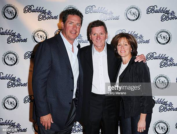 Former Miami Dolphin quaterback Dan Marino poses with Footy and his wife Claire at the 8th Annual Bubbles and Bows Gala benefitting Here's Help at...