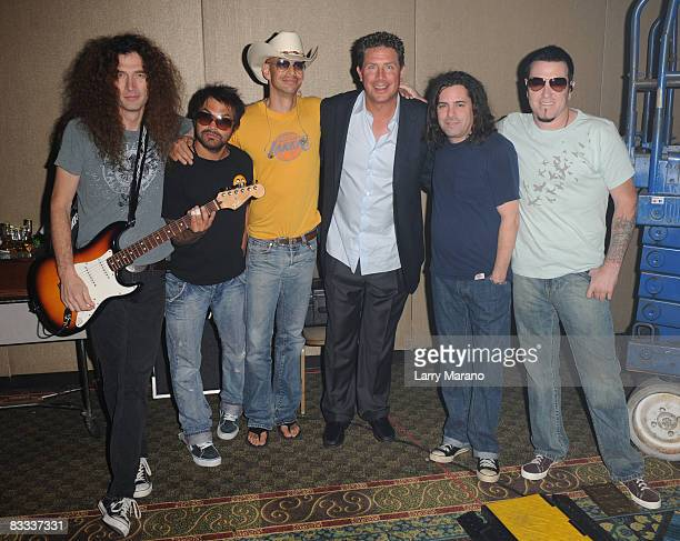Former Miami Dolphin quaterback Dan Marino poses with Smash Mouth at the 8th Annual Bubbles and Bows Gala benefitting Here's Help at Westin Diplomat...