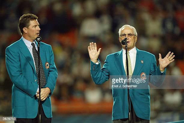 Former Miami Dolphins coach Don Shula speaks to the crowd as former quarterback Dan Marino watches before inducting former wide receivers Mark...