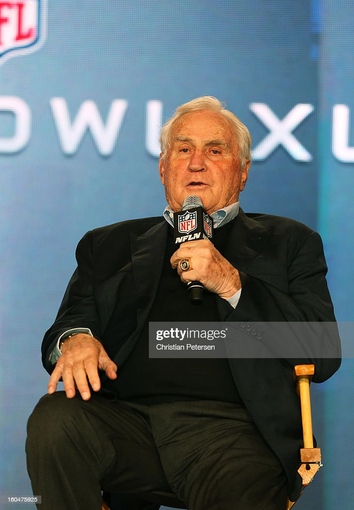 Former Miami Dolphins head coach Don Shula speaks as Head Coach Steve Specht, of St. Xavier High School in Cincinnati, is awarded the Don Shula High School Coach of the Year Award during a press conference for Super Bowl XLVII at the Ernest N. Morial Convention Center on February 1, 2013 in New Orleans, Louisiana.