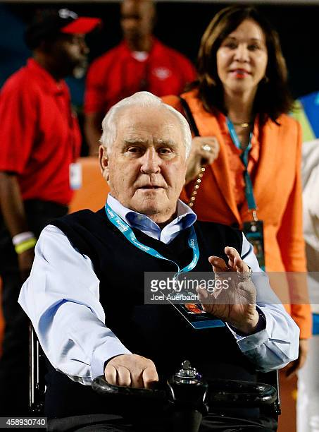 Former Miami Dolphins head coach Don Shula waves to a fan with his wife Mary Anne on the field before the Dolphins met the Buffalo Bills in a game at...