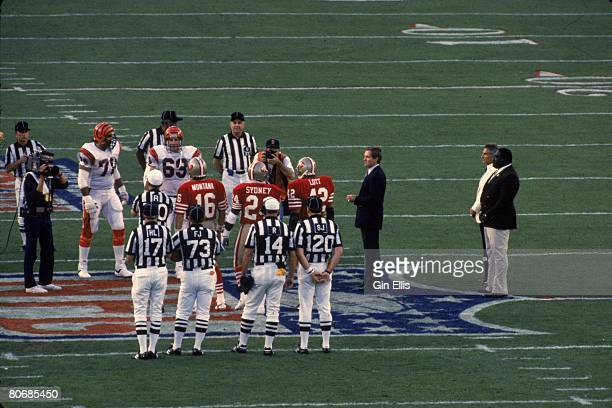 Former Miami Dolphins quarterback Bob Griese flips the coin with the former teammates Nick Buoniconti and Larry Little and the captains of the...