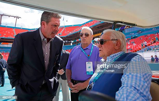 Former Miami Dolphins quarterback Dan Marino left speaks with former Dolphins head coach Don Shula right on the sideline before the Dolphins met the...
