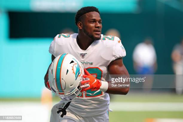 Former Miami Dolphins running back Mark Walton warms up before a game against the New York Jets at Hard Rock Stadium in Miami Gardens Fla on Nov 3...