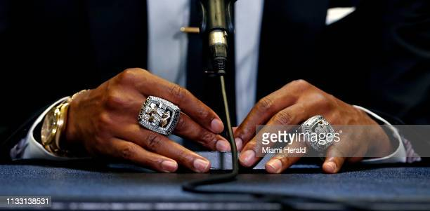 Former Miami Heat forward Chris Bosh speaks with the Media while wearing his championship rings before his jersey retirement ceremony during halftime...