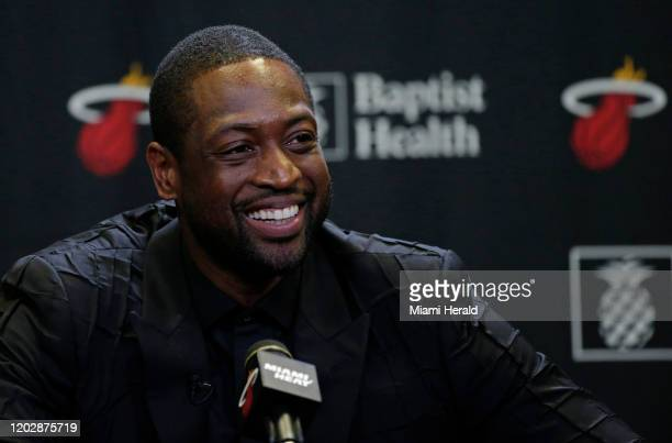 Former Miami Heat guard Dwyane Wade speaks to the media after his ceremony for his jersey retirement at halftime as the Heat host the Cleveland...
