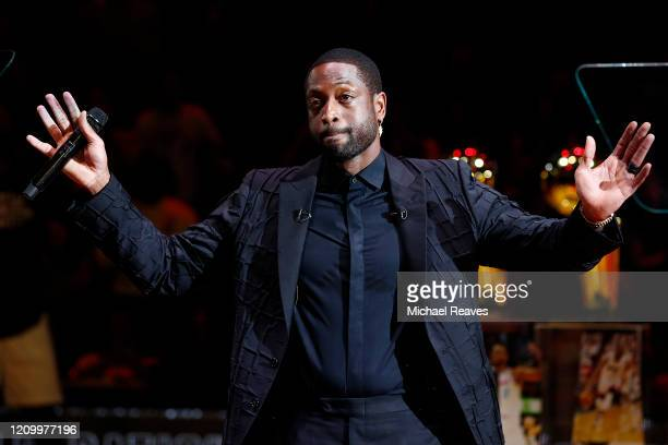 Former Miami Heat player Dwyane Wade addresses the crowd during his jersey retirement ceremony at American Airlines Arena on February 22, 2020 in...