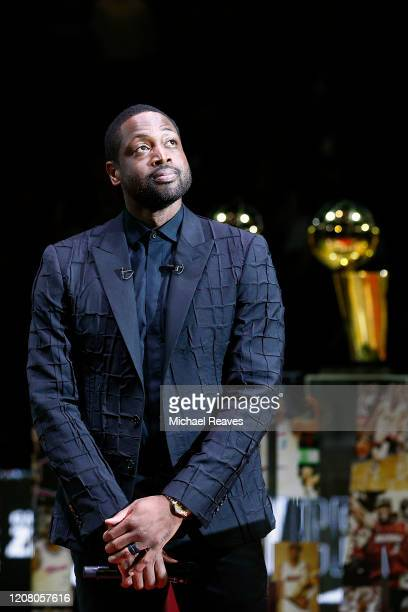 Former Miami Heat player Dwyane Wade looks on during his jersey retirement ceremony at American Airlines Arena on February 22, 2020 in Miami,...