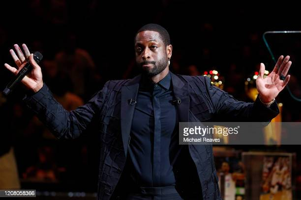 Former Miami Heat player Dwyane Wade reacts during his jersey retirement ceremony at American Airlines Arena on February 22, 2020 in Miami, Florida....