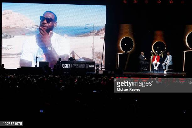 Former Miami Heat player Dwyane Wade watches a video from Lebron James during the Miami Heat Dwyane Wade L3GACY Celebration at American Airlines...