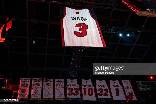 Former Miami Heat player Dwyane Wade's jersey is lifted to the rafters during his jersey retirement ceremony at American Airlines Arena on February...