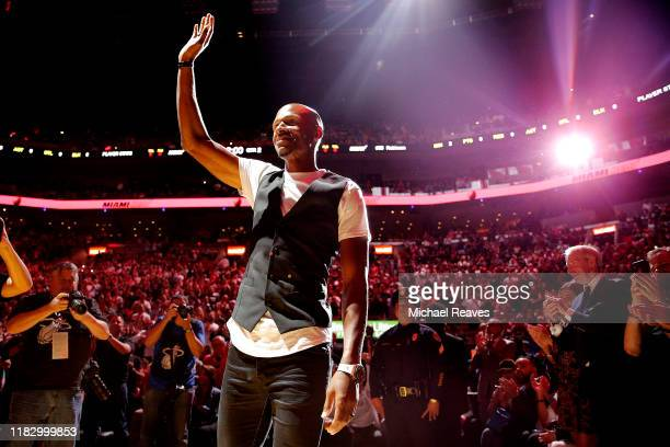 Former Miami Heat player Ray Allen is recognized during the first half between the Miami Heat and the Memphis Grizzlies at American Airlines Arena on...