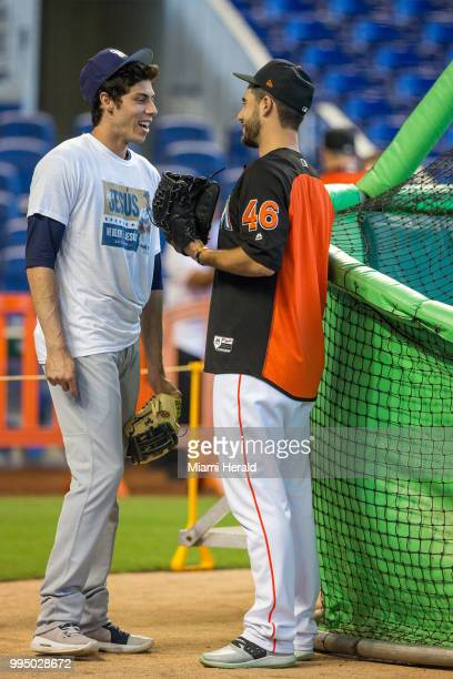 Former Miami Marlins Christian Yelich left now with the Brewers shares a moment during batting practice with Marlins pitcher Kyle Barraclough in his...