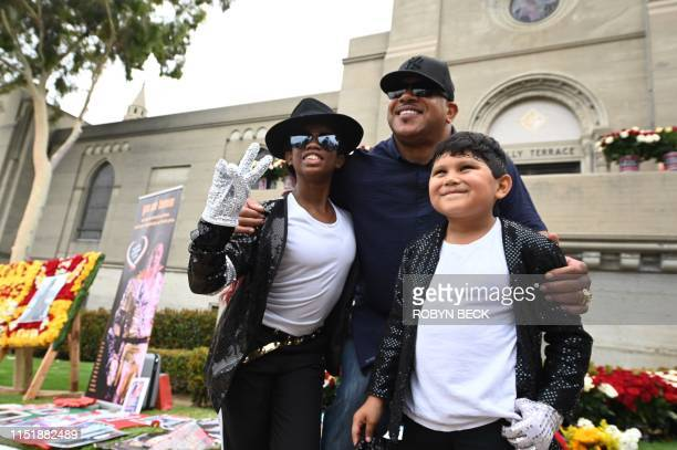 Former Michael Jackson bodyguard Bill Whitfield poses with Michael Jackson super fans Tanisha Woods and Dominic Lendo as fans remember the King of...