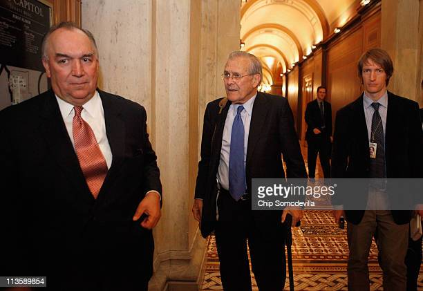 Former Michigan Governor John Engler and former Secretary of Defense Donald Rumsfeld walk through the halls of the US Capitol May 3 2011 in...