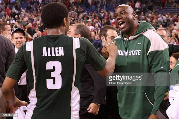 Former Michigan State player Earvin Magic Johnson and Chris Allen of the Michigan State Spartans celebrate after Michigan State's 64-52 win against...