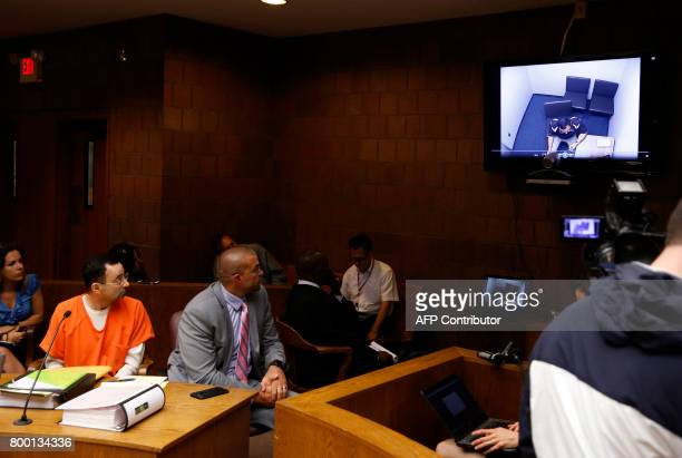 Former Michigan State University and USA Gymnastics doctor Larry Nassar watches a video his interview with the police in the 55th District Court...