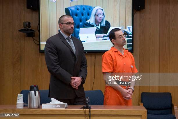 Former Michigan State University and USA Gymnastics doctor Larry Nassar accompanied by his attorney listens to Judge Janice Cunningham during his...