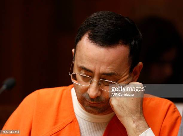 Former Michigan State University and USA Gymnastics doctor Larry Nassar is seen in the 55th District Court where Judge Donald Allen Jr bound him over...